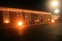 Huizen mooi verlicht voor de fakkeloptocht Beerta, Oldambt