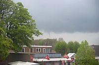 Slecht weer boven het dorp Beerta, Oldambt